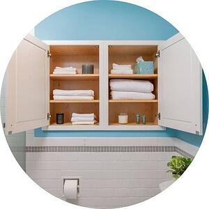 white Custom built-in storage cabinets in bathroom renovated by Bellweather design build in philadelphia