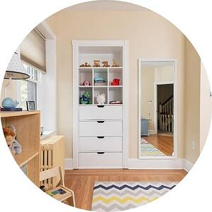 white custom built-in cabinets for toy storage in child's room by Bellweather design build in Philadelphia