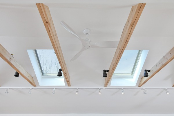 Attic Remodel with Windows and Ceiling Lights by Bellweather Design-Build