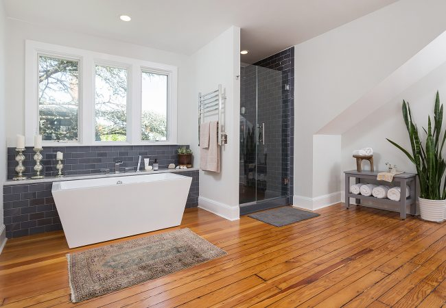 Large master bathroom in Chestnut Hill with designer white square bath and navy tiled shower by Bellweather design build