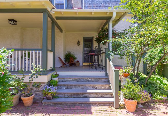 Chestnut Hill porch view from yard with stairs and door by Bellweather Design-Build in Philly