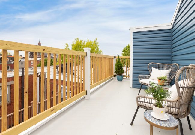 Fiber glass roof deck remodel with seating in Philadelphia by Bellweather Design-Build