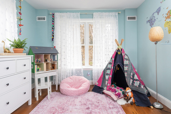 Girls Bedroom with pink and blue canvas teepee and pink beanbag chair in Philadelphia by Bellweather design build