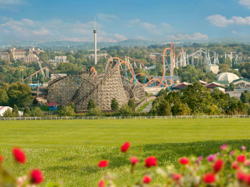 Hershey, PA amusement park with grassy field and red flowers - photo by AACA Museum
