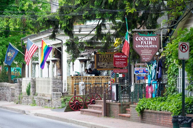 New hope, PA line of shops and businesses with pride flag - photo by Visit Bucks County