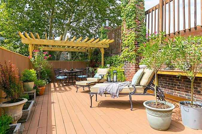 Outdoor roof deck remodel with pergola in Philadelphia by Bellweather Design-Build