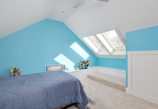 Blue wall attic bedroom conversion in Narberth, Borough by Bellweather Design-Build