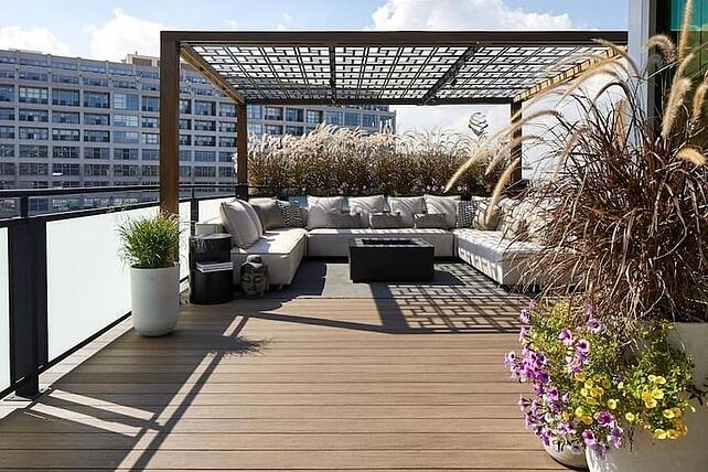 Composite rooftop deck with flowers and patio furniture in Philadelphia
