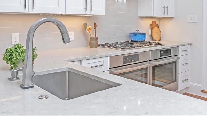 Off white quartz countertop kitchen with white shaker cabinets-2