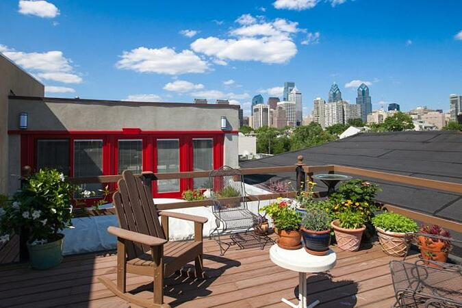 Rooftop deck with potted plants in Philadelphia by Bellweather Design-Build