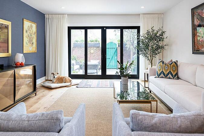 Transitional living room renovation with blue accent wall by Bellweather Design-Build in Philadelphia