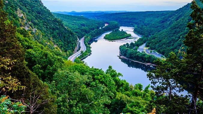 view of a river running through mountains in the Poconos, Pennsylvania