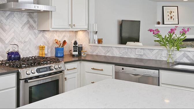 Two tone countertops for modern cabinets by Bellweather Design Build