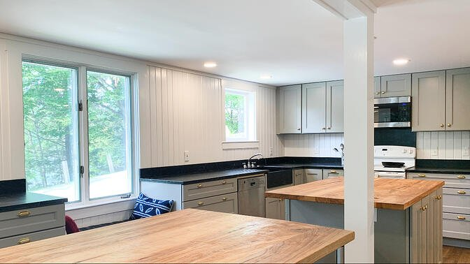 Vermont Farmhouse kitchen with soapstone and wood island counters