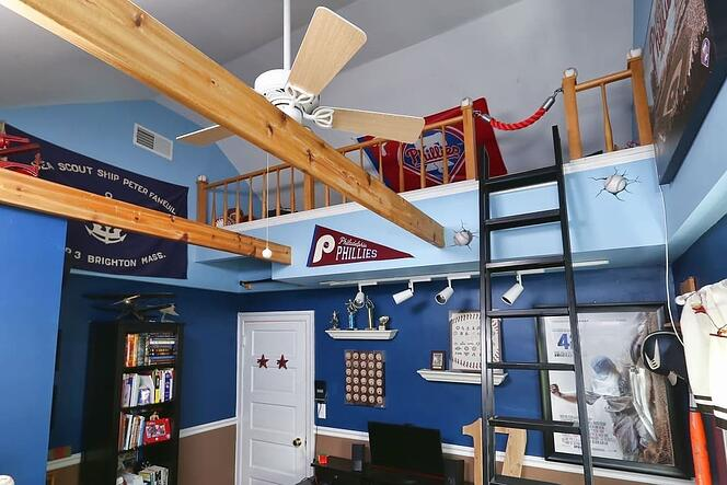 children's bedroom loft with blue walls and bunk bed in Narberth by Bellweather Design Build