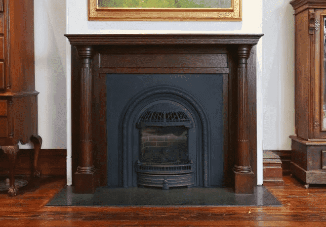 historic black metal fireplace in a victorian twin home in University City by Bellweather Design Build-png