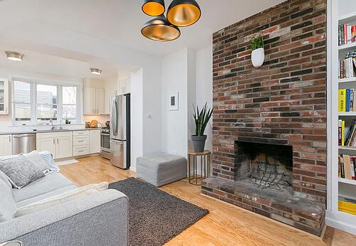 historic red brick fireplace in historic trinity home in center city by Bellweather Design Build