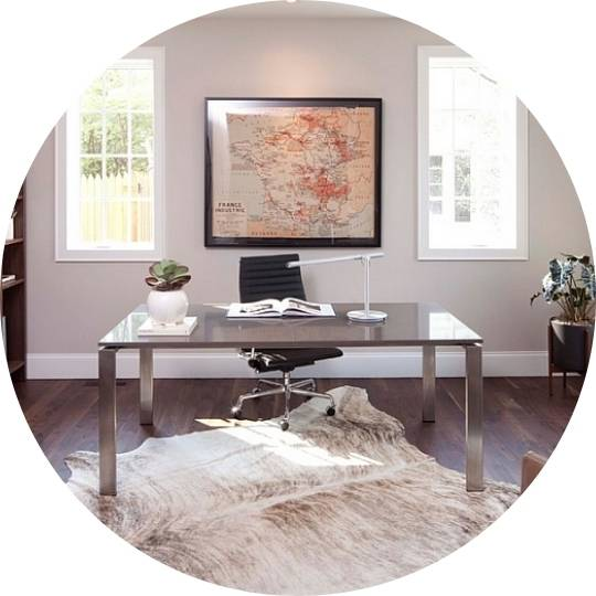 home office with large windows and grey desk with big map of france framed on wall