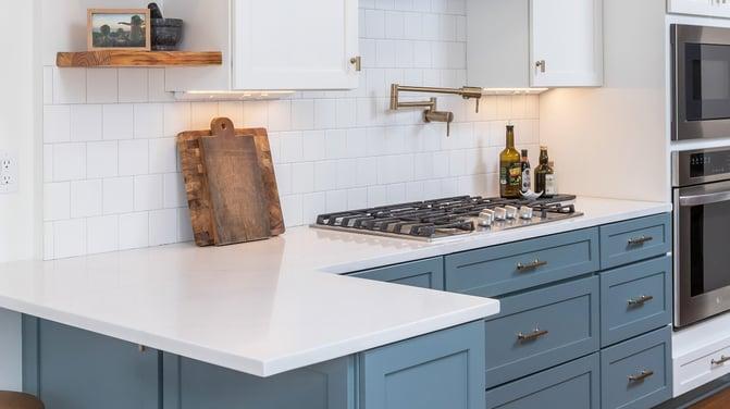 white quartz countertop on blue shaker cabinets-1